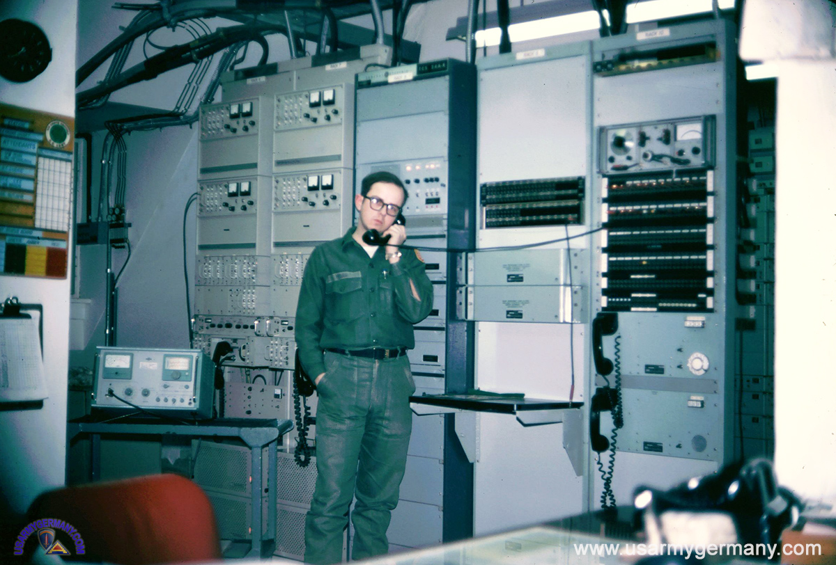 usareur partial photos th sig bn c company 447th signal battalion 1970 source tom horn tom horn at work inside the radio station at karlsruhe radio equipment behind tom is motorla