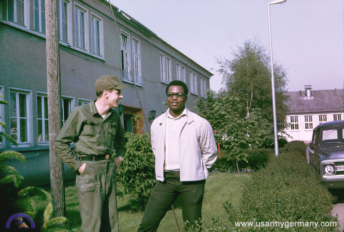 usareur partial photos th sig bn two members of c company standing in front of c company headquarters at neureut kaserne the hq c447 building had a small barracks and meeting room upstairs
